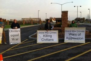 Protesters outside of Hancock Air National Guard Base.