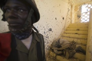 A Malian soldier discovered the body of an Islamist in Gao on Friday, where fighting has flared in recent days.
