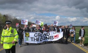 Protesters march to the perimeter fence of RAF Waddington, Lincolnshire to protest its use as a centre for drone piloting in Afghanistan. Photograph: Matthew Cooper/PA