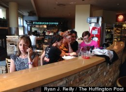 Medea Benjamin (left) of the anti-war activism group Code Pink fields media phone calls at a Starbucks after she interrupted President Barack Obama's major national security speech Thursday, May 23, 2013. (Ryan J. Reilly/The Huffington Post).